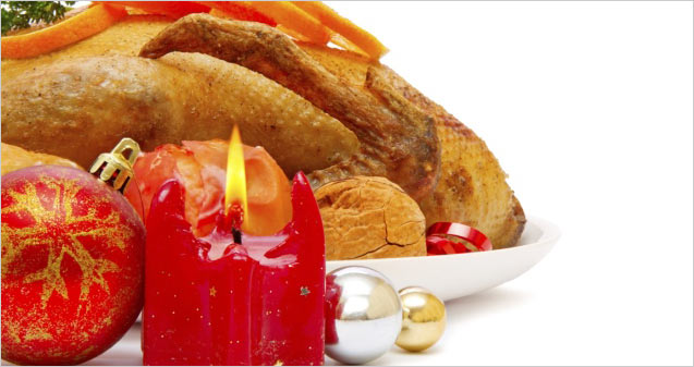 Christmas turkey dinner with a candle