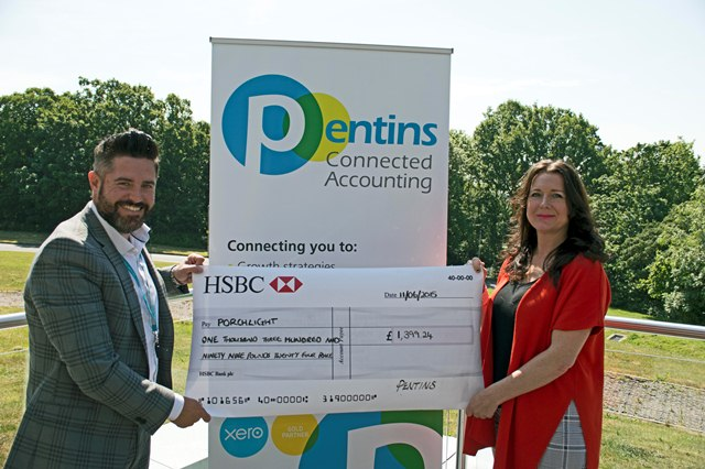 two people holding a cheque from Pentins