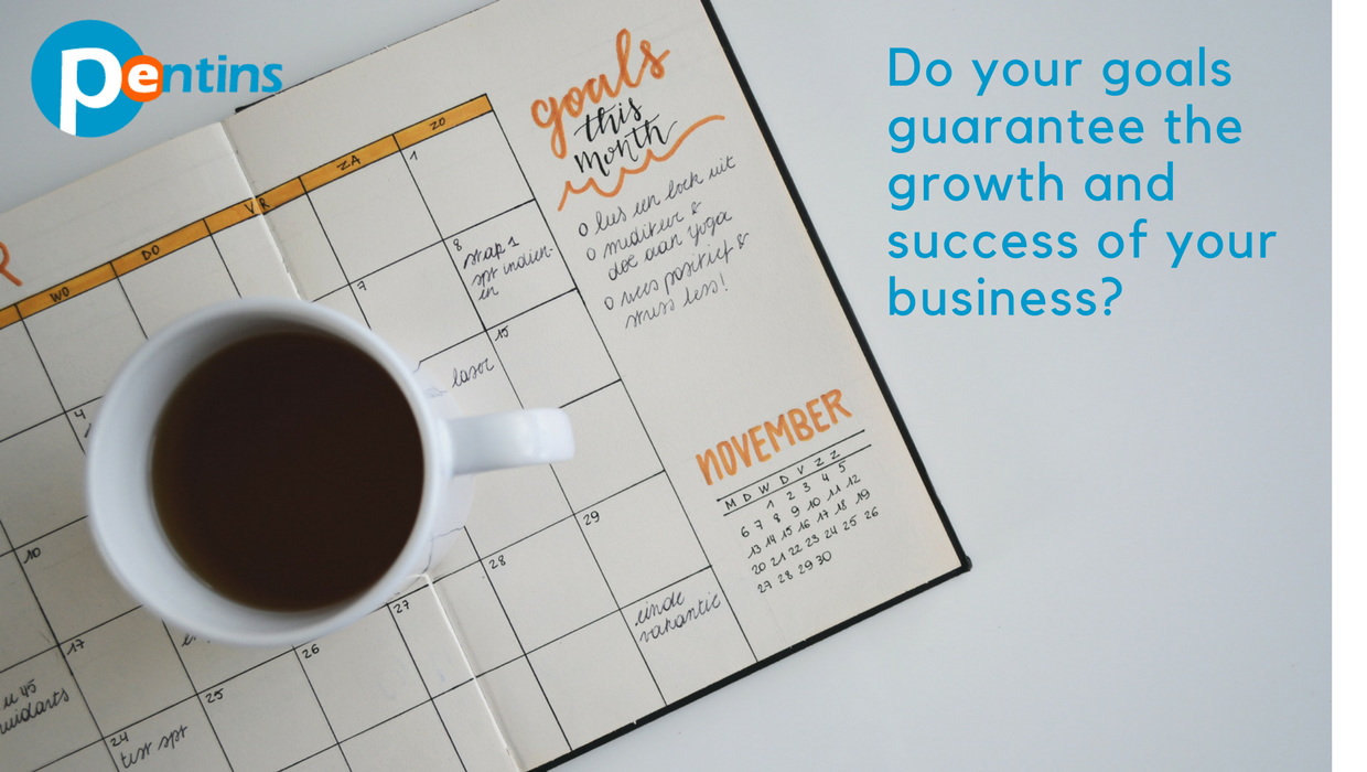 cup of coffee on top of calendar with monthly goals