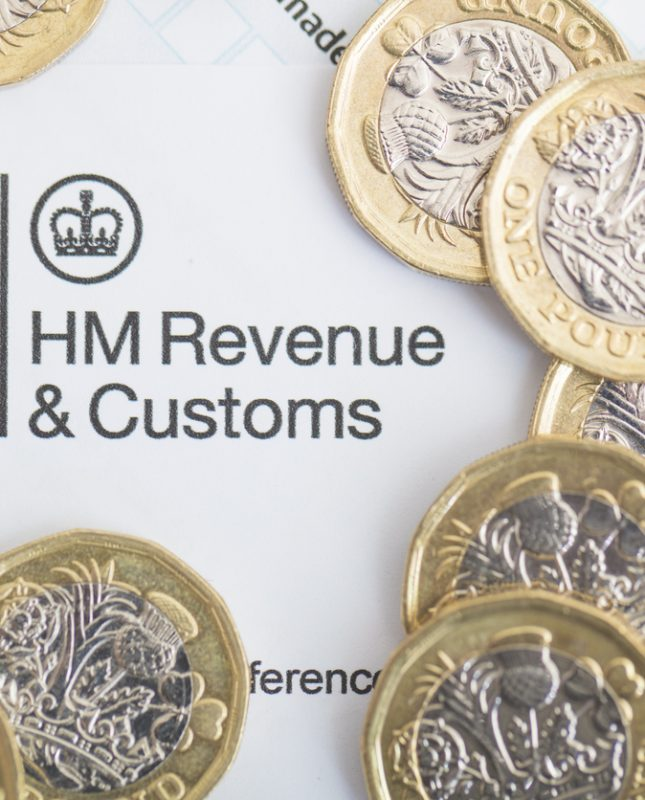 HMRC logo with pound coins around