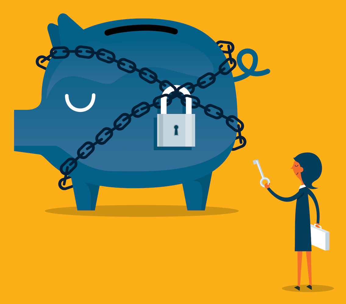 woman locking a piggy bank with a padlock